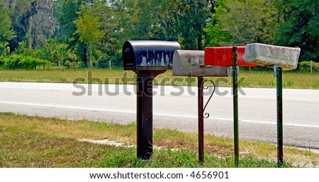Rural mail and paper boxes - stock photo