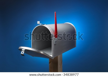 Rural metal mail box opened and sitting on wood post - stock photo