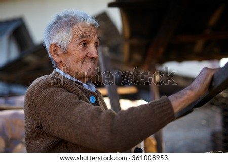 Rural old man smiling happy outdoor, closeup portrait - stock photo