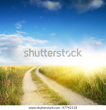 Rural road,blue sky and sun. - stock photo