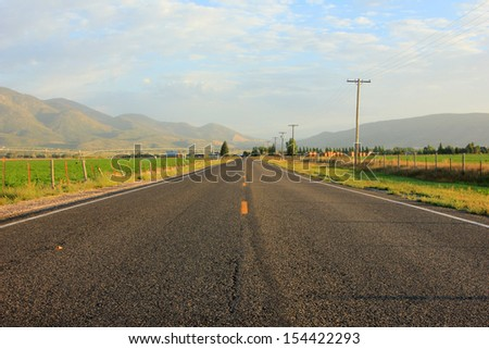 Rural road in the Utah countryside, USA. - stock photo