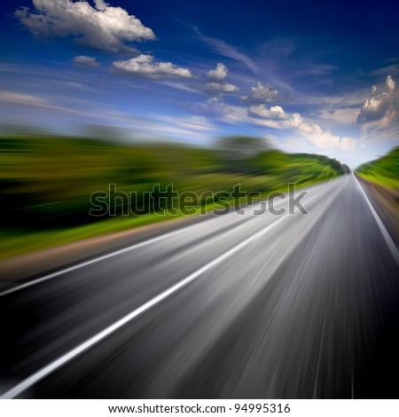 Rural road. Motion blur. - stock photo