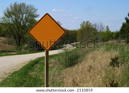 Rural Road Sign - Left blank to fill out with personal text. South-East Iowa rural road, only usable when dry. Not even pebbles beyond the sign, just plain dirt... - stock photo