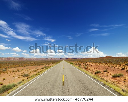 Rural State Route 261 in Utah with scenic landscape and blue sky in background. Horizontal shot. - stock photo