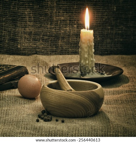 Rural Still Life With Mortar, Candle And Egg - stock photo