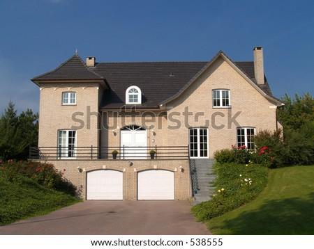Rural suburban house  with garden in belgium. - stock photo