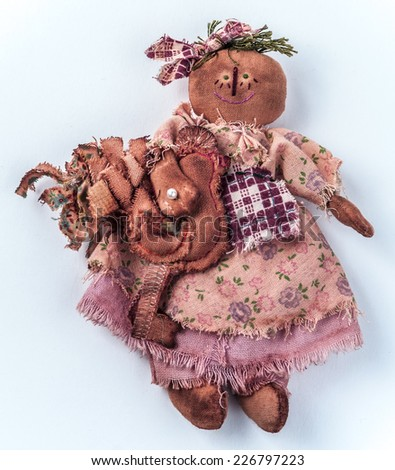 Rural textile doll for Halloween.  Folk tale creature with chicken. - stock photo