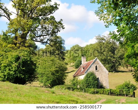 Rural View of a Small Cottage and Fields in the English Countryside - stock photo