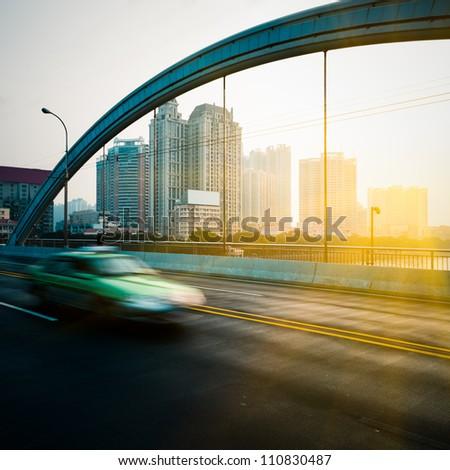 rush car in motion blur at street of guangzhou china. - stock photo