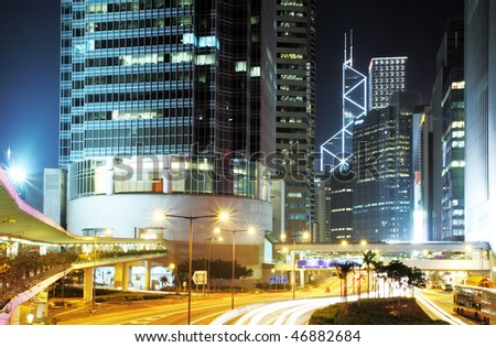Rush Hour Hong Kong Cityscape at Night. Corporate building at the back and busy traffic across the main road at rush hour. - stock photo