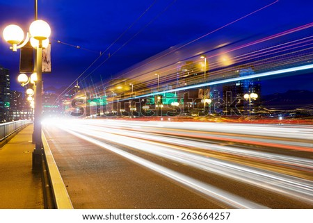 Rush Hour Traffic Light Trails on Cambie Bridge in Vancouver British Columbia Canada during Evening Blue Hour - stock photo