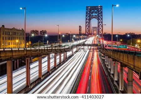 Rush hour traffic with light trails on George Washington Bridge, in New York City - stock photo