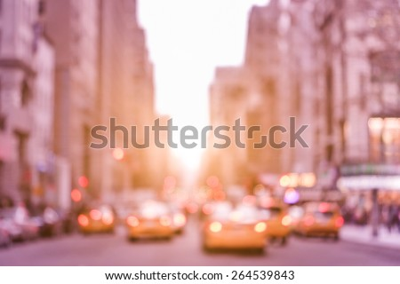 Rush hour with defocused yellow taxi cabs and traffic jam on 5th avenue in Manhattan downtown at sunset - Blurred bokeh postcard of New York City on a vintage marsala color filtered look - stock photo