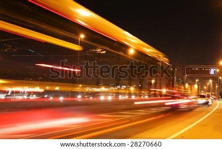 rush of night time traffic on road in  barcelona, spain - stock photo