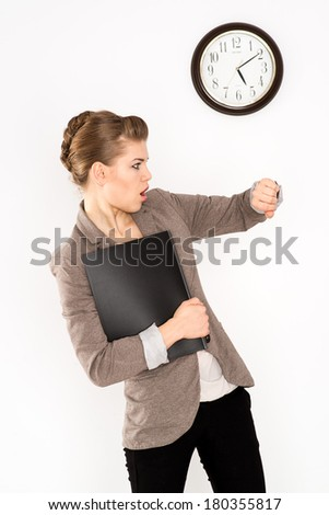 Rush time. Stressed woman looking at her watch in hurry, isolated over white background. - stock photo