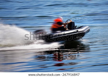 Rushing motor boat during the race - stock photo