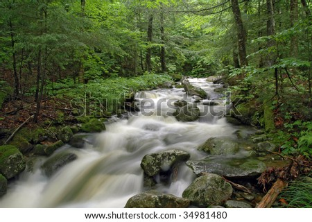 Rushing water at Dunn Falls, Andover, Maine, on a summer day - stock photo