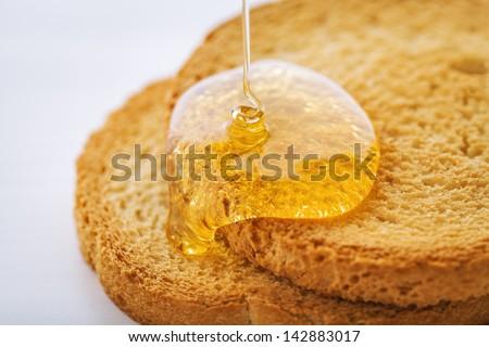 rusk and honey - stock photo