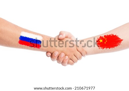 Russia and China hands shaking with flags painted on arms concept. Isolated on white background. - stock photo