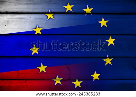 Russia and European Union Flag on wood background - stock photo