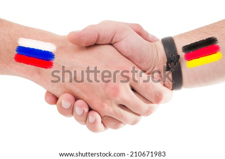Russia and Germany hands shaking with flags painted on arms concept. Isolated on white background. - stock photo