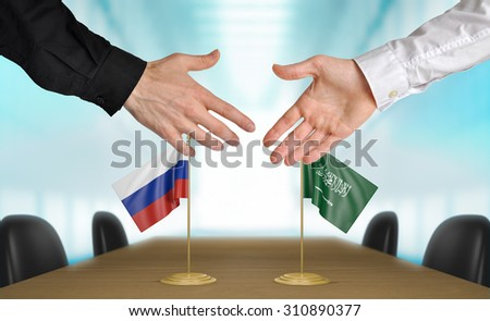 Russia and Saudi Arabia diplomats agreeing on a deal - stock photo