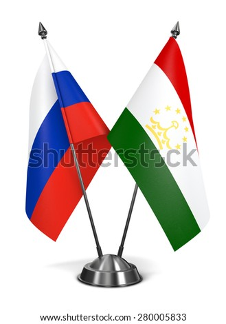 Russia and Tajikistan - Miniature Flags Isolated on White Background. - stock photo