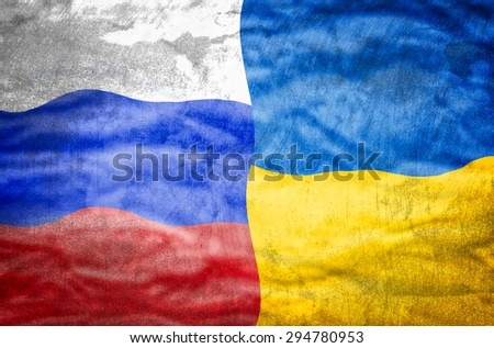 Russia and Ukraine mixed flag. Russia and Ukraine flag overlaid with grunge texture. - stock photo