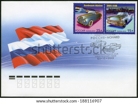RUSSIA - CIRCA 2013: A stamp printed in Russia shows Sunbeam Alpine and ZIL-111V, history of Automobile Production, a Joint Issue of Russia and Monaco, circa 2013 - stock photo