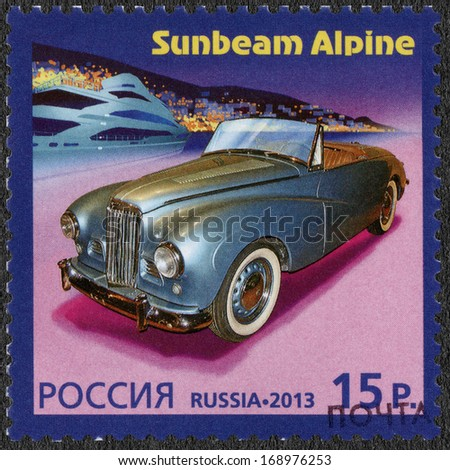RUSSIA - CIRCA 2013: A stamp printed in Russia shows Sunbeam Alpine, history of Automobile Production, a Joint Issue of Russia and Monaco, circa 2013 - stock photo