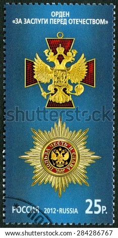 RUSSIA - CIRCA 2012: A stamp printed in Russia shows The Order For Merit to the Fatherland on the blue background, series State awards of the Russian Federation, circa 2012 - stock photo