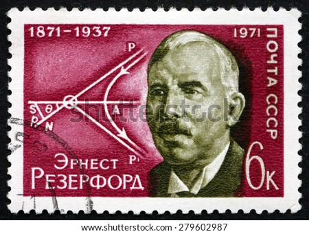 RUSSIA - CIRCA 1971: a stamp printed in the Russia shows Ernest Rutherford, British Physicist, Diagram of Movement of Atomic Particles, circa 1971 - stock photo