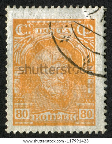 RUSSIA - CIRCA 1927-1928: stamp printed in USSR (Soviet Union), shows a peasant. 80 kop. Scott catalog A86, circa 1927-1928. - stock photo