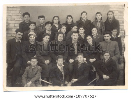 Russia CIRCA 1940 - Vintage photo of group of children at school with their teachers, circa 1940 - stock photo