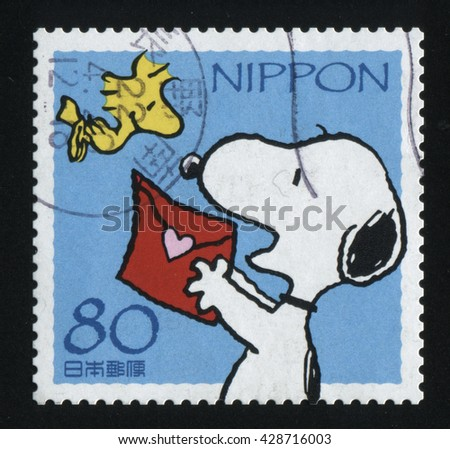RUSSIA KALININGRAD, 22 APRIL 2016: stamp printed by Japan shows puppy, circa 2012 - stock photo