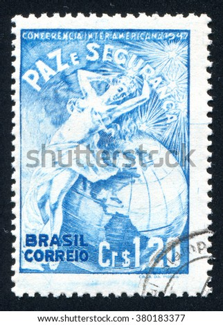 RUSSIA KALININGRAD, 13 MARCH 2014: stamp printed by Brazil, shows  Earth and woman, circa 1947 - stock photo