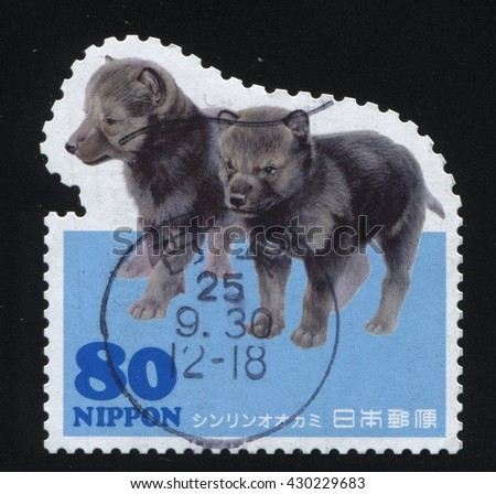 RUSSIA KALININGRAD, 18 MARCH 2016: stamp printed by Japan shows puppy, circa 2007 - stock photo