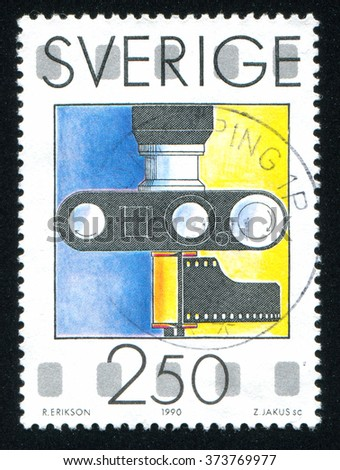 RUSSIA KALININGRAD, 6 OCTOBER 2013: stamp printed by Sweden, shows Camera, circa 1990 - stock photo