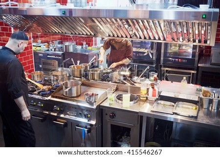 RUSSIA, MOSCOW - DEC 28, 2014: Cooks in the kitchen prepare food in the restaurant Siren (Lilac), located in Sokolniki park at Pesochnaya alley. - stock photo