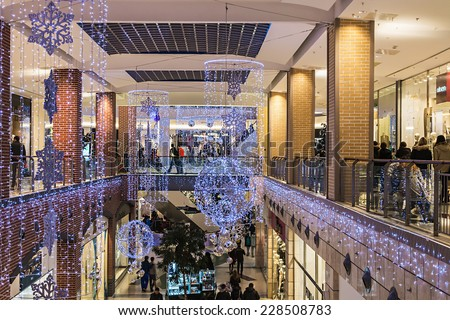 RUSSIA, MOSCOW - December 21, 2013: People enter to Metropolis shop before Christmas, Russia. Metropolis - the largest shopping and entertainment center of Moscow. - stock photo