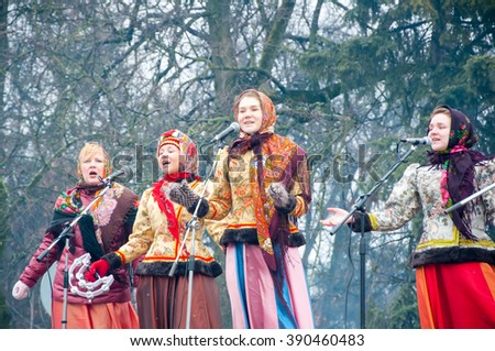 RUSSIA, MOSCOW-MARCH 13: The group of women sing a song, on Maslenitsa, in traditional Russian clothes on March 13, 2016 in Moscow. Maslenitsa is a week-long festival before Great Fast. - stock photo