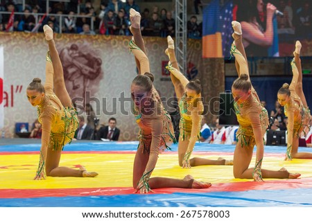 RUSSIA, MOSCOW - MARCH 27, 2015: Unidentified sportsmen of Russian national gymnastics aesthetic team dance on World Sambo Championship Kharlampiev memorial in Luzhniki sport palace, Moscow, Russia, 2015 - stock photo