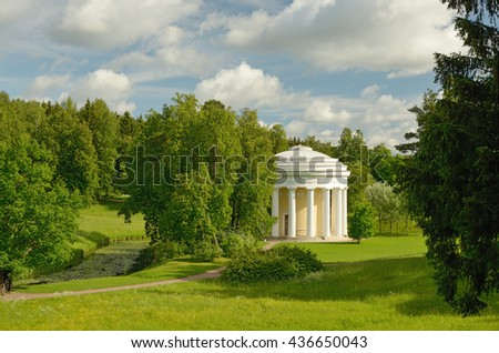 Russia.Pavlovsk.Country Park with a rotunda.Around a lot of vegetation.Blue sky oblakami. - stock photo