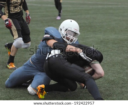 RUSSIA, PODOLSK CITY - JULY 27: Zurab  Stankidze (95, black) fights on friendship football game Spartans vs Vityazi on July 27, 2013, in Moscow region, Podolsk city, Russia - stock photo