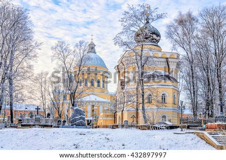 Russia. Saint Petersburg. Alexander Nevsky lavra at a frosty winter day. Holy Trinity Cathedral and St.Nicholas church and the cemetery. - stock photo