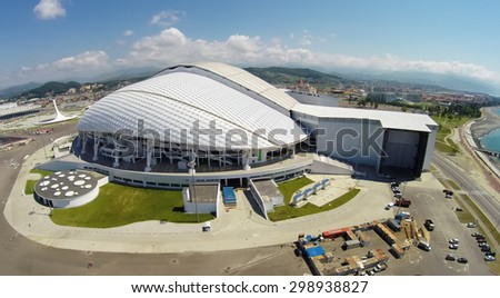 RUSSIA, SOCHI - JUL 26, 2014: Fisht Olympic Stadium at summer sunny day. Aerial view. Photo with noise from action camera. - stock photo