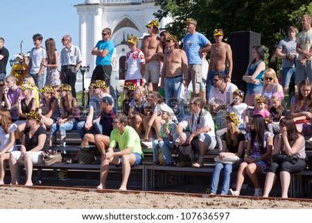 RUSSIA, VLADIMIR - JUNE 23: 1st international beach volleyball tournament event June 23, 2012 in Vladimir, Russia.  People looking  beach volleyball tournament - stock photo