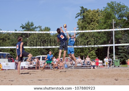 RUSSIA, VLADIMIR - JUNE 23:  Unidentified players in action at 1st international beach volleyball tournament event June 23, 2012 in Vladimir, Russia.  Players during semifinal of volley tournament - stock photo