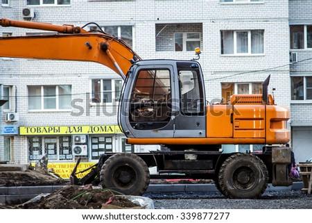 RUSSIA, VORONEZH - 14 NOV 2015: Construction machinery: Excavator - stock photo