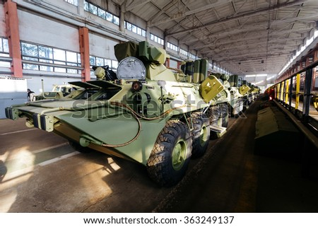 Russian armored personnel carrier with a weapon in the hangar - stock photo
